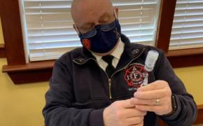 East Providence Battalion Chief Michael Carey prepares dosages of COVID-19 Vaccine. Carey and the East Providence Emergency Management Agency team will begin providing vaccines to East Providence school teachers and staff and East Providence residents living in congregate living facilities.