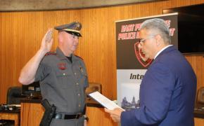 Lt. Darren Ellinwood is sworn in by Mayor Bob DaSilva