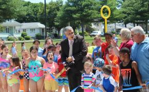 East Providence youth together with Mayor DaSilva, Sen. Val Lawson and Council VP Rodericks cut the ribbon on the Pierce Field Splash Pad