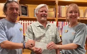 Dave O'Connell, executor of the Len Iannacone estate, provides gift to Jeff Faria and Cheryl Faria of the Historical Society
